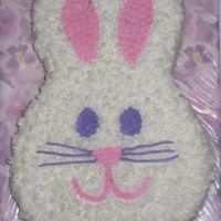 Furry Easter Bunny Cake  I made this for an Easter BBQ tomorrow. Lemon Cake with Lemon Curd filling. Whipped Cream BC Frosting. I used the grass tip to make the...