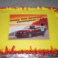 Ford Mustang Cake   I made this for my son's 10th birthday. The pic on top is laminated. Vanilla cake with chocolate mousse filling.