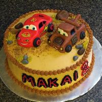 "Mater & Mcqueen Lightning McQueen & Tow Mater sculpted cakes, covered in MMF on top of a 9"" round covered in BC...... Fondant rocks. I'm..."