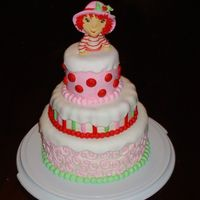 Strawberry Shortcake Tower Entire cake done with buttercream & fondant, including the figurine.