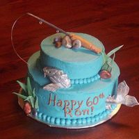 Sturgeon Cake Inspired by amberhoney's fish cake & also one of Collette's. Gumpaste fish, rod & reeds, fondant rocks. The fish had to...