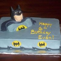 Batman Busts Out! The Batman bust is out of rice krispies, covered in fondant, the little beacons are also fondant, everything else buttercream frosted. I...