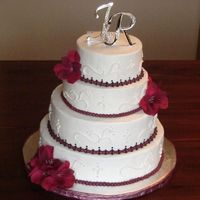 "Burgundy Wedding A 12"", 10"", 8"" and a 6""; all different flavours. The bride provided the artificial flowers, and the initials. I made..."