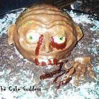 Zombie Cake This zombie was made out of the 3D ball pan & chocolate rolled buttercream for the skin!