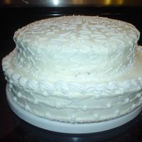 Pratice White 2 Tier I am new to this and I wanted to try something different. I made it with cream cheese frosting and decorated it with BC. I used the super...