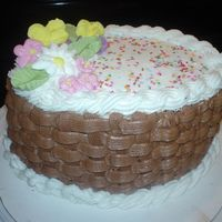 My First Basket Weave Cake This is my wilton course 2 basket cake. Most of my royal flowers broke so this is what was left. I made it with chocolate buttercream.