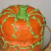 My Very First Pumpkin Cake  I have to say Kudos to all that have made this cake! This is a monster to frost!! My top bundt is pumpkin spice and the bottom is DG Choco...