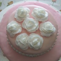 Tier-2-2.jpg This was my first attempt at making a tiered cake. Also, my first real try with fondant. Cake was filled with lemon curd/ blueberry filling...