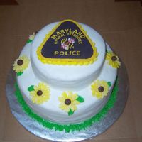 "100_3935.jpg This is a 'Welcome Back"" to work cake for a friend that took a leave of absence to be homewith her baby. The flowers are Maryland..."
