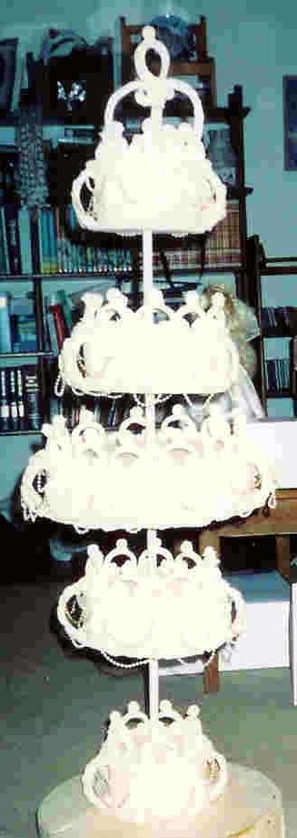 Cakes_033.jpg This is a dummy cake with royal icing decorations. It turned out fantastic but it was only my third wedding cake. I was not about to...