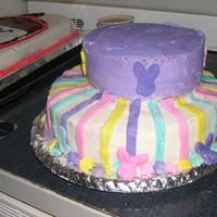Easter Stripes This is a nice pastel colored cake with bunny heads on the sides and stripes all made out of fondany!