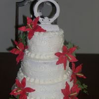 My 1St Wedding Cake This was my first wedding cake the bride wanted white and simple with the red lilies... I ordered the lilies online since there was no time...