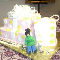 Birthday Presents View 2 Close up view of little girl Wii game and soccer ball. All made of fondant. Kudos to Cake Central for all the beautiful photos
