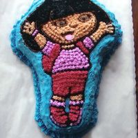 Dora   My very first cake. I made it for my daughter's 3rd birthday last year.