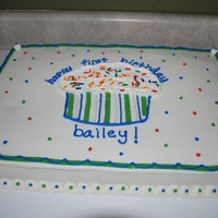 First Birthday Cupcake Cake 12x18 sheet cake. All buttercream. Cupcake was printed off the computer and traced.