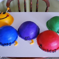 Baby Einstein Caterpillar I used the half ball pan for the humps. The facial features are chocolate and the antenna are lollipops.