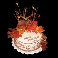 Autumn Birthday This cake was done for the mom of a man I work with. Marble cake, bc icing, silk flowers.