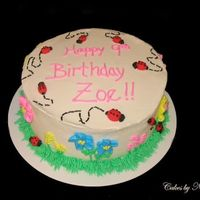 Zoe Ladybug Birthday This cake was made for the daughter of a lady I work with. BC icing with fondant ladybugs.