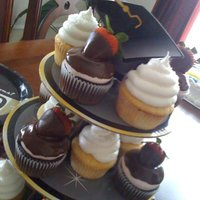 Graduation Cupcakes Chocolate Covered Strawberry and Vanilla Sugar cupcakes (Sorry for the crappy cell phone picture!!)