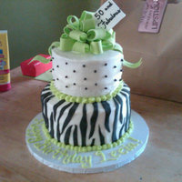 "Zebra Birthday Cake 8"" Chocolate and 6"" Coconut cakes with Vanilla and Coconut buttercream. Fondant zebra stripes, gumpaste bow and gift tag."