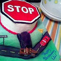 Stop Sign/cars Cake This was for a little boy turning 5 who is very into road signs and is having a Disney Cars themed b-day party. 2 10 inch yellow cakes iced...