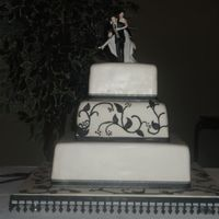 Derek And Dana's Black And White Wedding Cake This cake was made for some friends she wanted a simpler cake because the groom picked out the cake topper. I think she made the right...