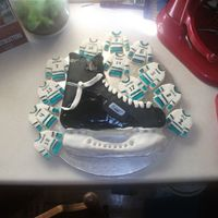 Hockey Skate Cake And Jersey Cookies  My son had his hockey wind-up so this is what I came up with. He doesn't like cake so much which is why I did cookies as well. It...