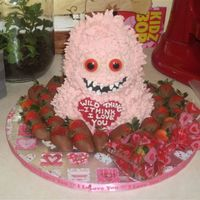Valentine Wild Thing  I got the idea from a Wilton website added the chocolate strawberries for fun the cake is a 3d bear pan and the heart is melted chocolate...