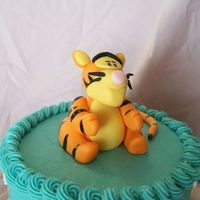 Tigger Tigger cake, 6 inch white cake with BC, fondant Tigger and dots. Thanks to swillshaz, her Tigger cake was my model!