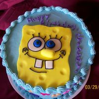 Spongebob fondant bob and flowers on the side.