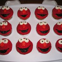 Elmo Cupcakes My sister and I made these for my daughter's 1st birthday. They were a huge hit! We iced them in red bc icing and then dipped them in...