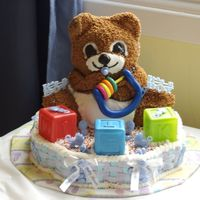 Baby Shower Cake This was a baby shower cake made with the teddy bear 3d pan and the bottom is a petal pan cake.