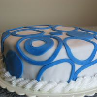 Blue Circle Cake Round cake covered in Fondant then with blue findant circles.