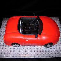 Convertible Miata My husband has 2cars, but his favorite is a convertible Miata he paid $500 for so I made a replica of it for his birthday. Car cakes don&#...