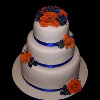 Gator Wedding  The bride and groom were having a Florida Gator themed wedding and wanted orange and blue flowers. The finished product has hearts on it...