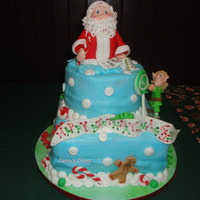 Santa Claus   I had so much fun with this cake. I could have kept going and adding to it. Everything is edible.