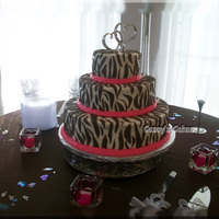 Hot Pink Zebra Wedding Cake  I have always made smaller zebra style cakes, this was the first zebra wedding cake for me. It has a hot pink buttercream ribbon with...
