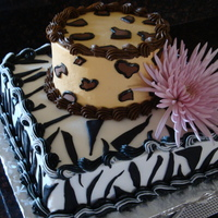 "Animal Print  Black & white cake with vanilla buttercream. Bottom was a 10"" squre with the zebra print, and the top was a 6"" round with the..."