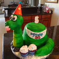 Dino-Mite 3-D dinosaur made for a little boy's 5th birthday. Cake was red velvet with vanilla vb. Covered with MMF and then airbrushed the color...