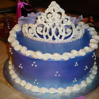 Tiara Cake Royal icing tiara with sugar pearls. Airbrushed with amerimist lavender pearl color. Gumpaste fantasy flowers