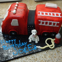 Fire Engine Cake Fire engine made for a firefighter friend of mine. Dalmation & hydrant made of MMF w/ tylose. Had to hand paint the entire cake cause...