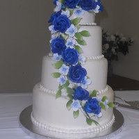 Blue Rose Ice Cream Cake My first ice cream wedding cake. Bettercream iced with gumpaste flowers.