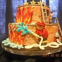 Ace Will Be A Fireman Just Like Daddy Fondant covered cake with brick impression. Gumpaste fireman, flames, fire hydrant, ladders, beagle dalmation (I tried for a straight up...