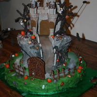 Castle Dracula Cake chocolate cake, chocolate castle,trees,fence,door,everything edible execpt trinketes on trees. thanks to the dvd from Susan Carberry.