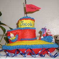 Tug Boat Cake For my son's 1st birthday. I used the Wilton football cake pan for the base.