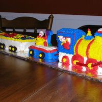 Train Cake I used the Wilton cake pan and then used mini bread pans for the fright cars. This was for my baby's 1st birthday. He got the cake...