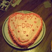 First Valentine's Day Cake This is my first V-Day cake I made for my family. My little sister insisted I do these decorations so I couldn't do what I wanted :(....
