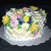 The Flowers Of Easter Egg shaped vanilla cake with lime curd filling. Iced with buttercream, decorated with royal icing flowers. The flowers were practice from...