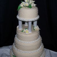 "Calla Lily Wedding Cake Calla Lilies are gumpaste w/petal dust accents. Ivory fondant with royal and buttercream decorations. 12"" layer is vanilla w/bavarian..."