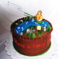 Fly Fishing 30Th Birthday Cake is chocolate with chocolate ganache filling and chocolate icing. Fishing figure and fishing basket are made from gumpaste. The pole...